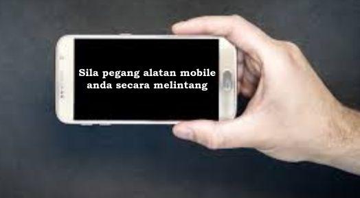 pegang alatan mobile secara melintang
